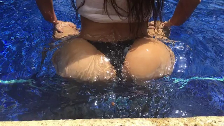 Kim Kardashian twerks her famous bottom in the pool.